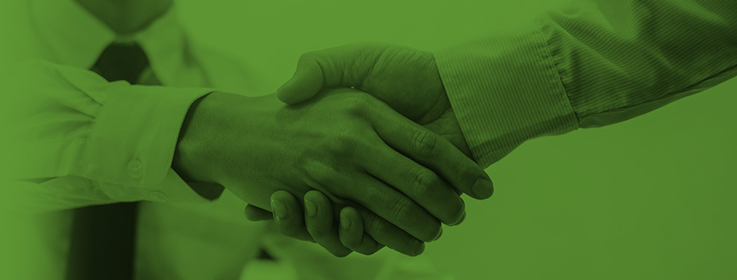 Two PPC Loan employees shaking hands